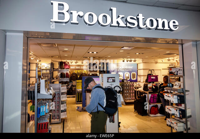 Charlotte North Carolina Charlotte Douglas International Airport inside terminal concourse gate area shopping Brookstone - Stock Image