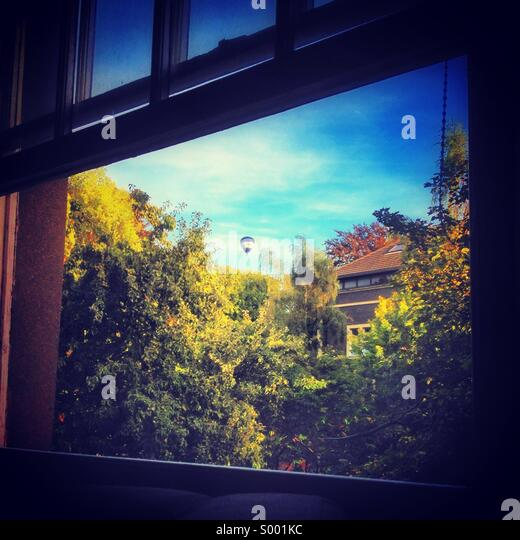 Looking out of a window on a pleasant day - Stock Image