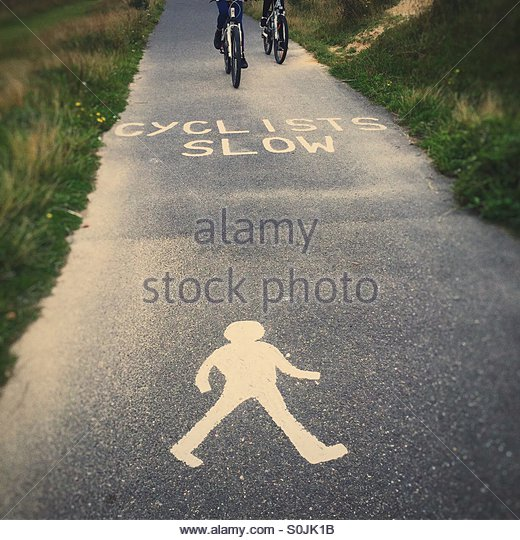 'Cyclists Slow' sign, Cycle & Pedestrian Path - Stock Image