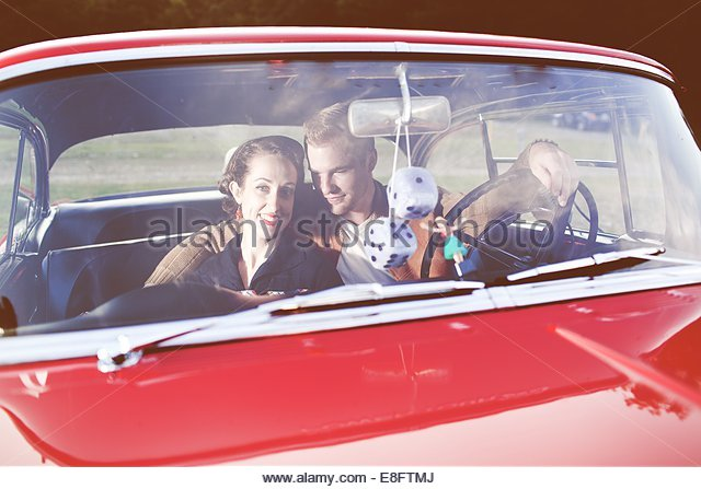 Young couple in vintage car - Stock Image