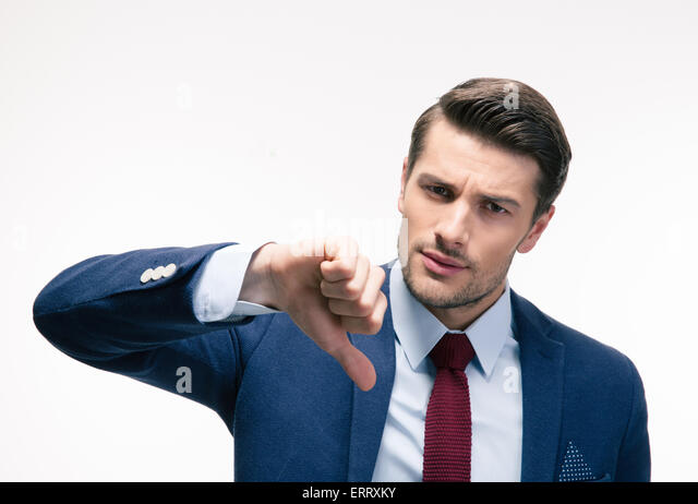 Young handsome businessman showing thumb down sign isolated on a white background. Looking at camera - Stock Image