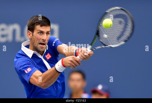 New York, USA. 11th Sep, 2015. Novak Djokovic of Serbia returns a shot to Marin Cilic of Croatia during their men's - Stock-Bilder