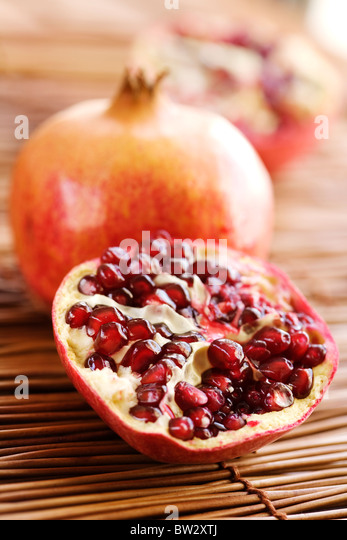 ripe open pomegranate - Stock Image
