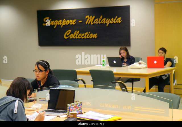 Singapore National University of Singapore NUS school student campus Central Library Asian woman studying Malaysia - Stock Image