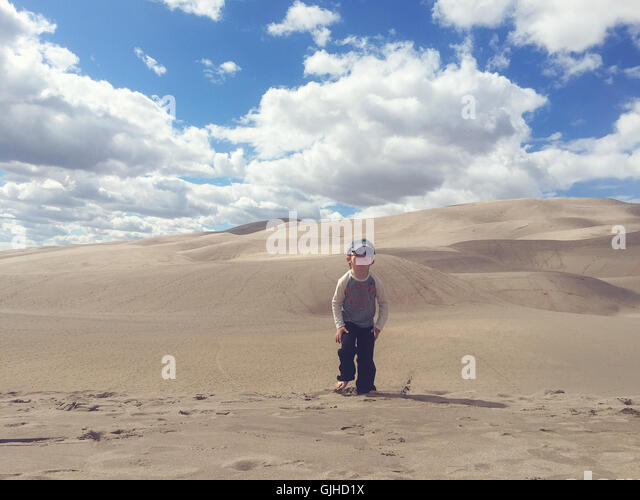 boy walking in Great sand dunes national park, Colorado, america, USA - Stock Image