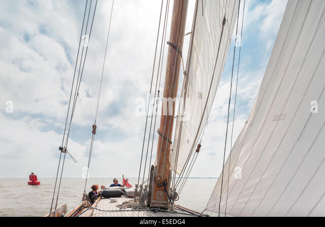 Sailing on the Waddenzee Wadden Sea on a traditional Lemsteraak sailing ship sailboat. Netherlands Unesco World - Stock Image