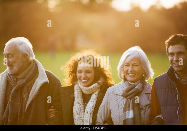 Family walking together in park - Stock-Bilder