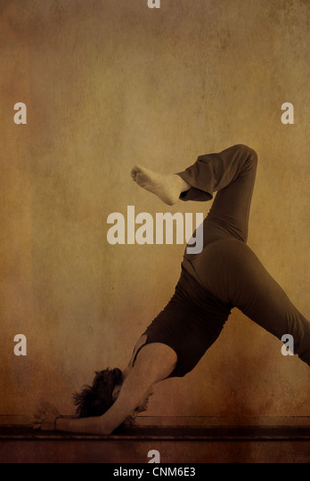 Woman in a variation of the yoga pose Dolphin. Photo illustration. - Stock Image