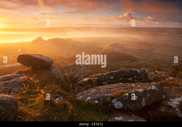 Sunrise over a misty moor viewed from Littaford Tor, Dartmoor, Devon, England. Autumn (October) 2011. - Stock Image