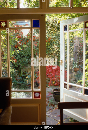 Double doors stained glass stock photos double doors for Double open french doors