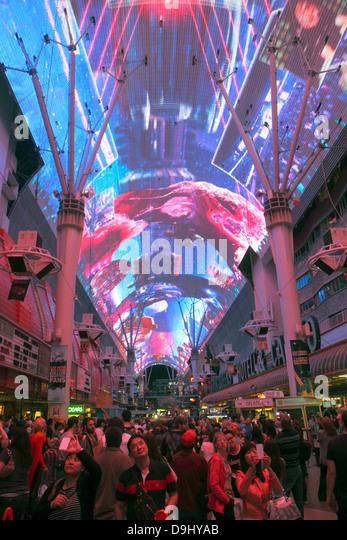 Nevada Las Vegas Downtown Fremont Street Experience pedestrian mall night nightlife neon signs Viva Vision canopy - Stock Image