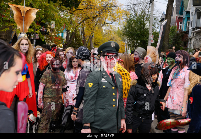Mob of bloody Zombies waiting to begin annual Toronto walk at Kensington Market - Stock Image