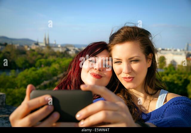 Two young women taking self portrait, Vienna, Austria - Stock Image