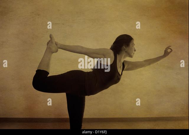 Woman in yoga pose indoors. Photo based illustration. - Stock Image