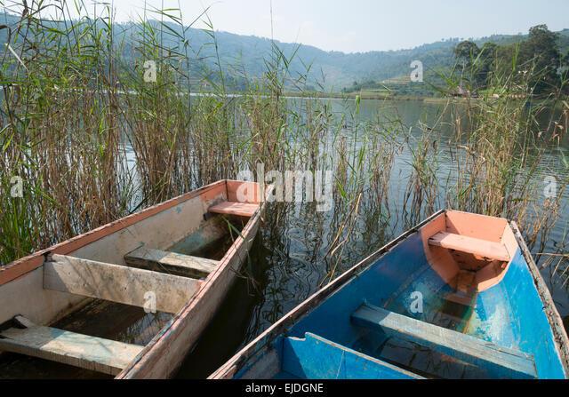 Two dingy boats on lake Bunyonyi. Uganda. - Stock Image