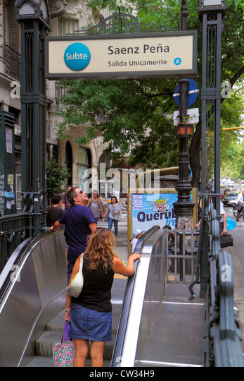Argentina Buenos Aires Avenida de Mayo street scene Subte underground subway station exit escalator sign Spanish - Stock Image