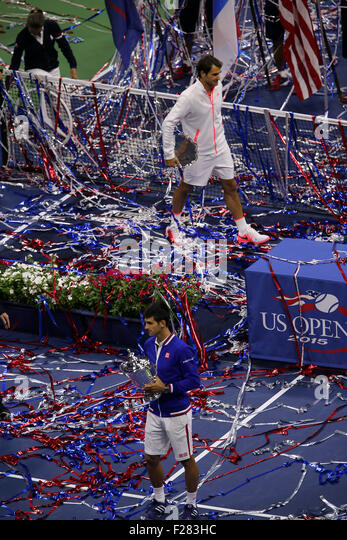 New York, USA. 13th Sep, 2015. Novak Djokovic of Serbia receives the U.S.  Open trophy as streamers fly through - Stock Image