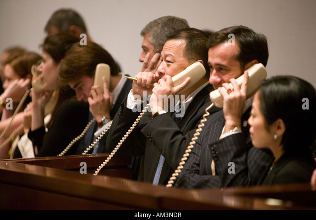 Christie employees takes bids over the phone during an auction in New York City USA November 2006 - Stock Image