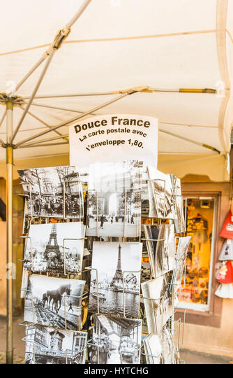 historic black and white picture postcards in a stand showing the eiffel tower and historic scenes of french everyday - Stock-Bilder