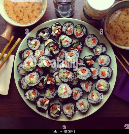 Homemade vegetarian sushi with miso soup - Stock Image