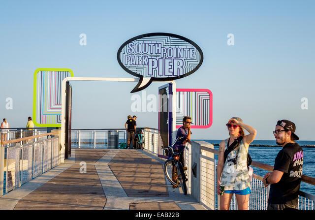 Miami Beach Florida South Pointe Park Pier Atlantic Ocean water man woman couple - Stock Image