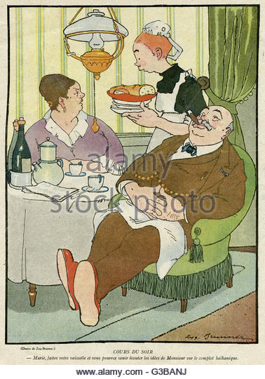 A maid serves a bourgeois  French couple at supper.         Date: 1916 - Stock Image
