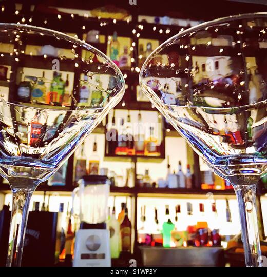 Couple of empty martini glasses in a cocktail bar - Stock Image