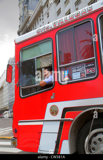 Argentina Buenos Aires Avenida 9 de Julio street scene bus charter transportation Hispanic man driver job looking - Stock Image