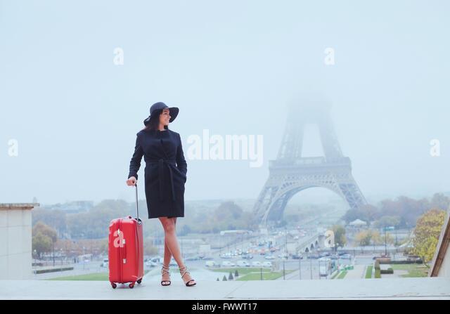 tourist in Paris, Europe tour, woman with luggage near Eiffel Tower, France - Stock-Bilder