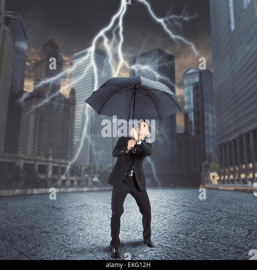 Businessman against lightning - Stock Image