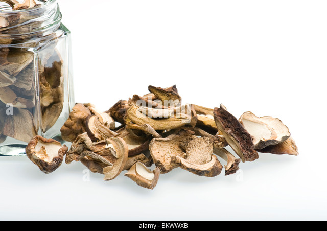 Porcini Mushrooms And Jar On White Background - Stock Image