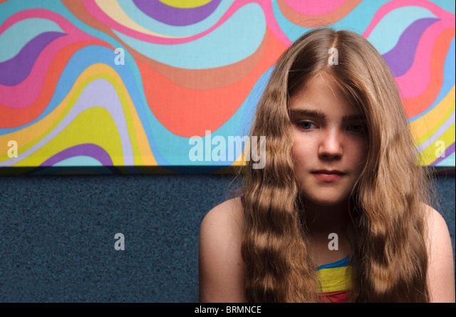 Young girl with abstract painting - Stock Image