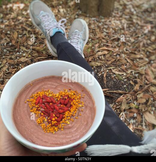 Smoothie bowl post work out - Stock Image