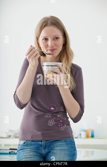 ADOLESCENT WITH HOT DRINK - Stock-Bilder