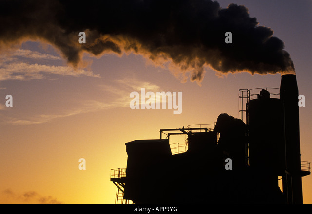 Smoke billowing out of tower - Stock Image