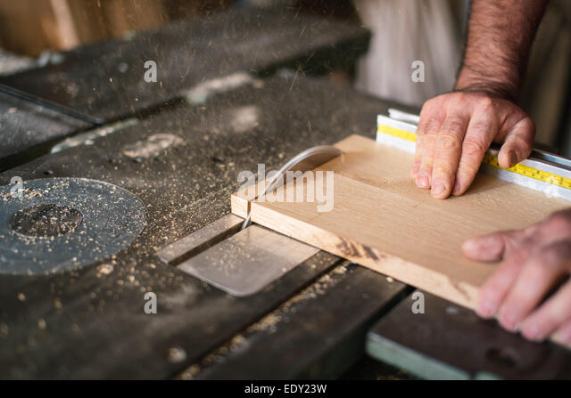 Carpenter working on the circular saw - Stock Image