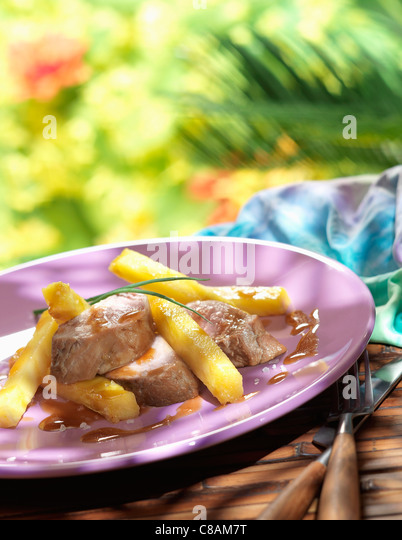 Pork filet mignon with pineapple chips - Stock Image