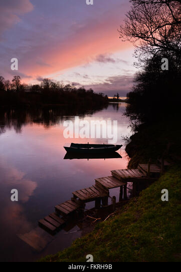 Angling boat on the River Tweed near Birgham where the river forms the Scottish Border. - Stock Image