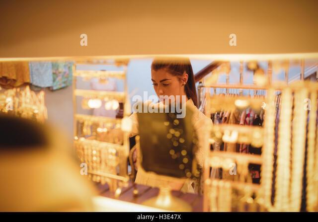 Woman selecting a jewellery - Stock Image