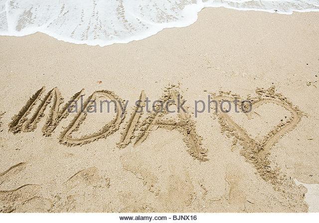 India written in sand - Stock-Bilder