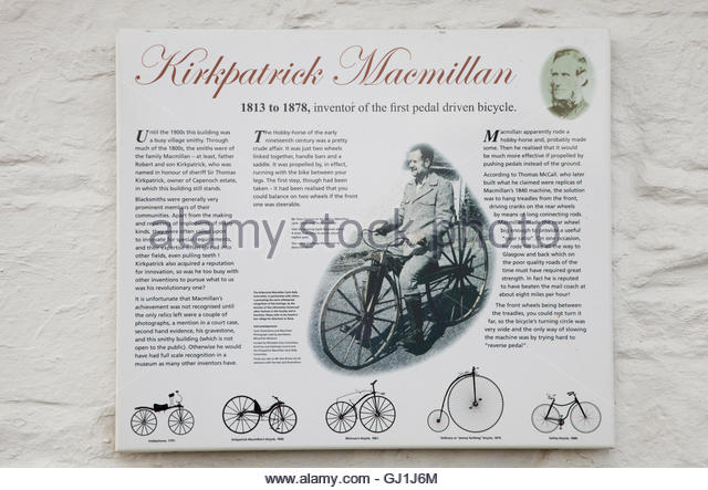 An information panel on the exterior wall of the building (a former smithy) near Penpont, where Kirkpatrick Macmillan - Stock Image
