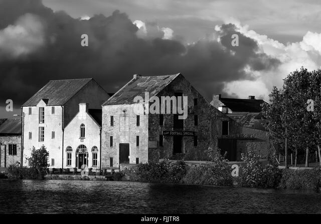 Old warehouses in Ramelton, Fanad Peninsula, County Donegal, Ireland - Stock Image