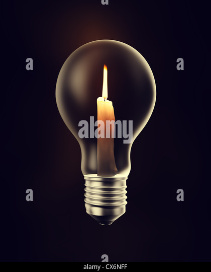 A burning candle inside a light bulb - Stock Image