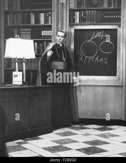 Bishop Fulton Sheen presents an illustrated theology lesson on his TV show, LIFE IS WORTH LIVING. Dec. 13, 1954. - Stock Image