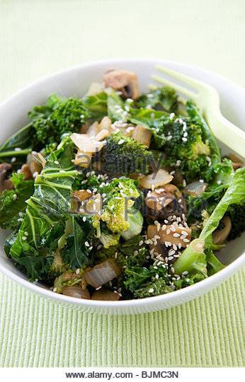 Green Stir Fry with Onions and Sesame Seeds - Stock Image