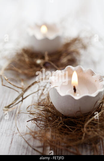 Easter egg shell candles on top of nest - Stock Image