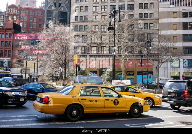 New York City NY NYC Manhattan Lower Financial District Broadway traffic yellow taxi cab - Stock Image