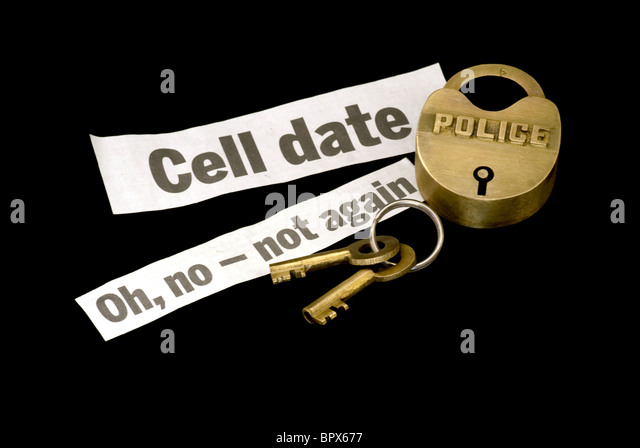 Police lock and keys with jail cell date warning as a repeat offender - Stock Image