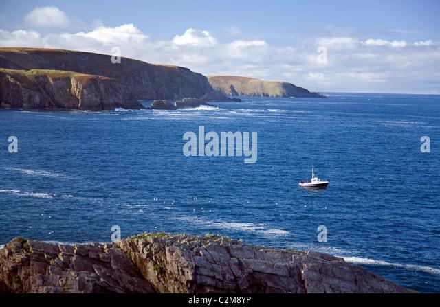 Sea angling boat near Erris Head, County Mayo, Ireland. - Stock Image
