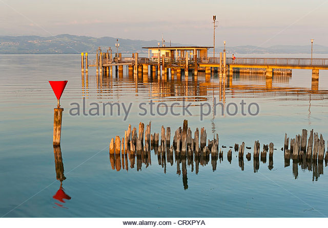 Germany, Wasserburg, View of jetty with old  wave breaker at dawn - Stock Image